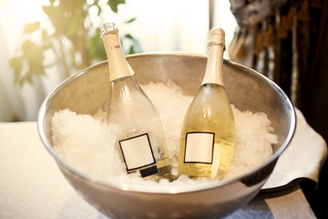 Bottles with champagne in ice