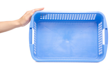 Plastic blue laundry basket in hand