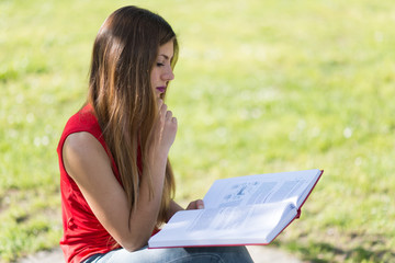 Woman reading a book outdoor
