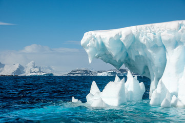 Jaws of Ice - Iceberg surrounded by turqouise sea, Antarctica