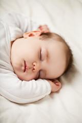 Sleeping newborn baby at home, bedtime