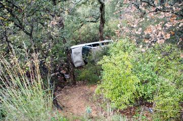 Rumpled car in a ditch.