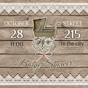Baby shower card on wooden background