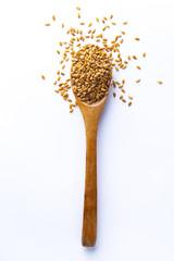 Fotobehang Zonnebloem Spoon full of quinoa grains on white background