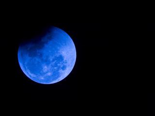 Blue eclipse in a black background