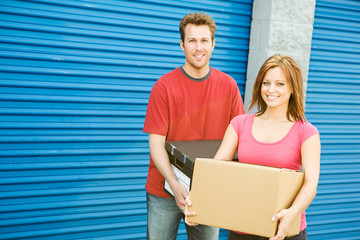 Storage: Couple Carrying Boxes to Unit