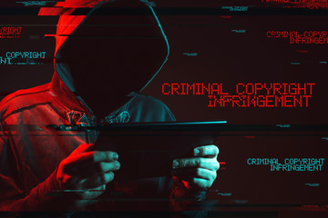 Criminal copyright infringement concept with faceless hooded male