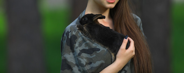 a girl with a black rabbit