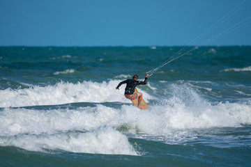 unknown kite boarder heads out to sea