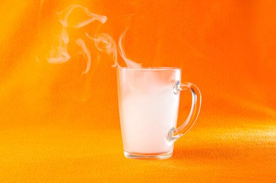 Mug with smoke on an orange background