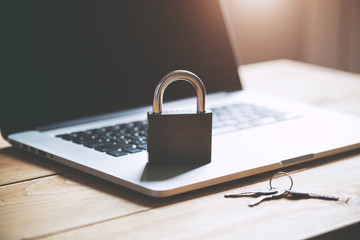 Lock on laptop as computer protection and cyber safety concept. Private data protection from hacker malware