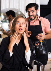 Woman shocked by the work makeup artist