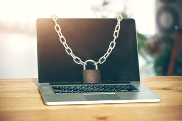 Locked chain on laptop as computer protection and cyber safety concept. Private data protection from hacker malware