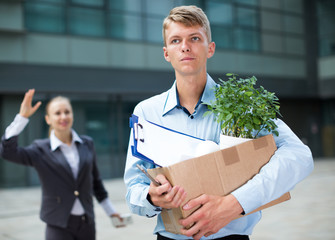 Manager in suit is standing upset near office