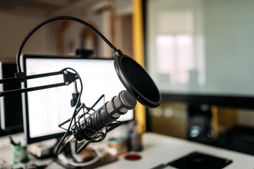 Podcast studio: microphone and computer.