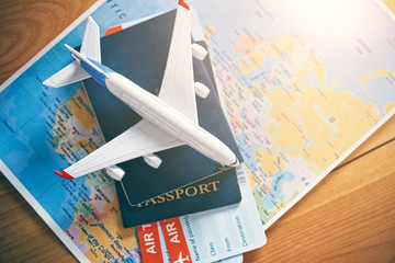 Türaufkleber Flugzeug Plane model with world map, passports and tickets as airplane traveling and tickets booking concept