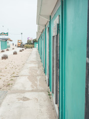 view of green cabins in the beach