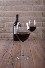 A glass of red wine on a wooden table