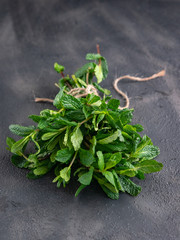 Fresh mint leaves herb on stone table. selective focus.