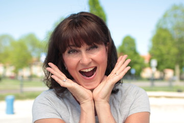 Beautiful happy woman outside