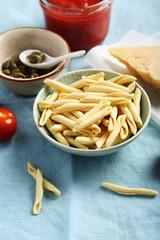 Uncooked pasta and sauce ingredients