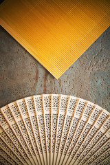 retro background with old looking feather and golden fluttered paper