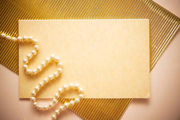 invitation background with  feather and golden fluttered paper