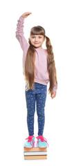 Little girl measuring her height on white background
