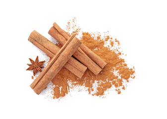 Aromatic cinnamon sticks and powder on white background