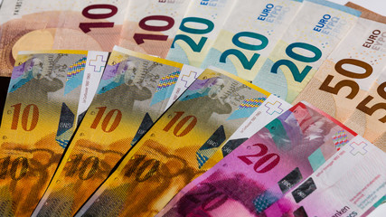 euro and swiss franc bills