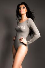 Portrait of beautiful model in body suit