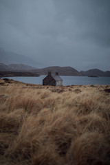 Remote house in front of a lake