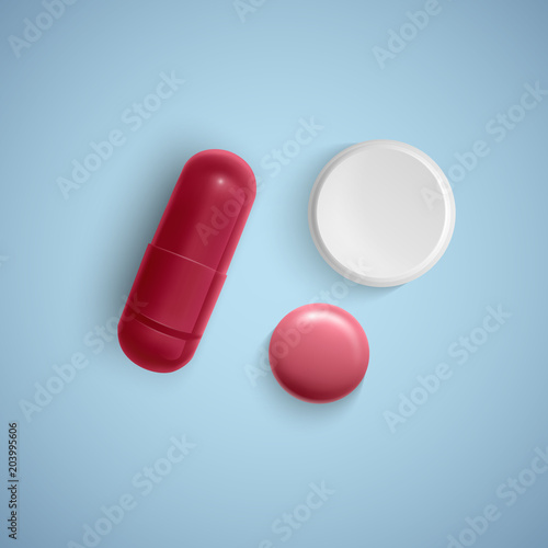 realistic capsule and a pill on a white background medicine red