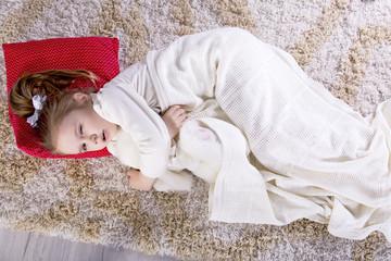 The child sleeps on the floor in the children's room