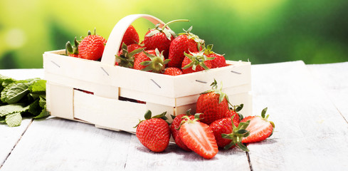 fresh red strawberries in a basket. healthy fruit concept