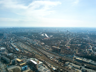 Panoramic view of the city of Kiev and the railway against the blue sky, aerial view