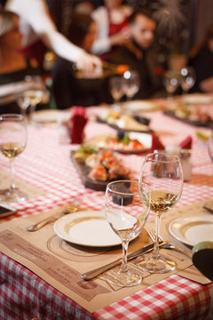 the table is served with glasses for white wine
