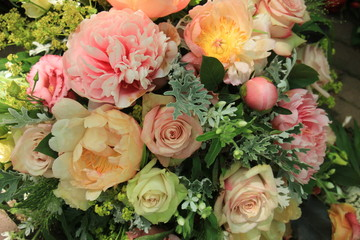 Mixed pink spring bouquet: roses and peonies