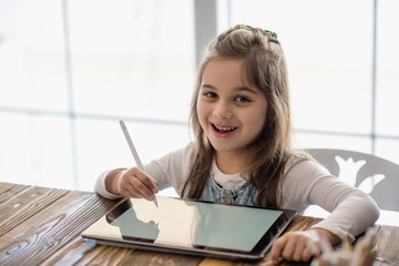 Little Girl Drawing Digital Picture On Electronic Touch Pad With Blutooth Pen