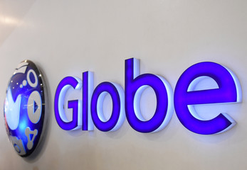 A logo of Globe Telecom is seen at a Globe service center in Edsa, Quezon City, metro Manila