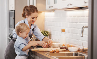 happy family in kitchen. mother and child baking cookies  .