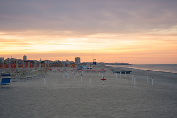 Wall Mural - Typical beach of the Romagna Riviera at sunset.