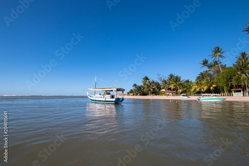 Tropical Island With Fishing Boat In The Sea