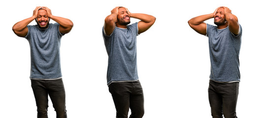 African american man with beard stressful keeping hands on head, terrified in panic, shouting