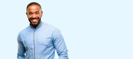 African american man with beard confident and happy with a big natural smile laughing isolated over blue background