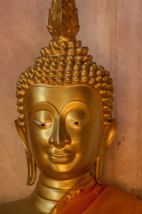 head of gold image buddha in the old temple Ayutthaya, Thailand