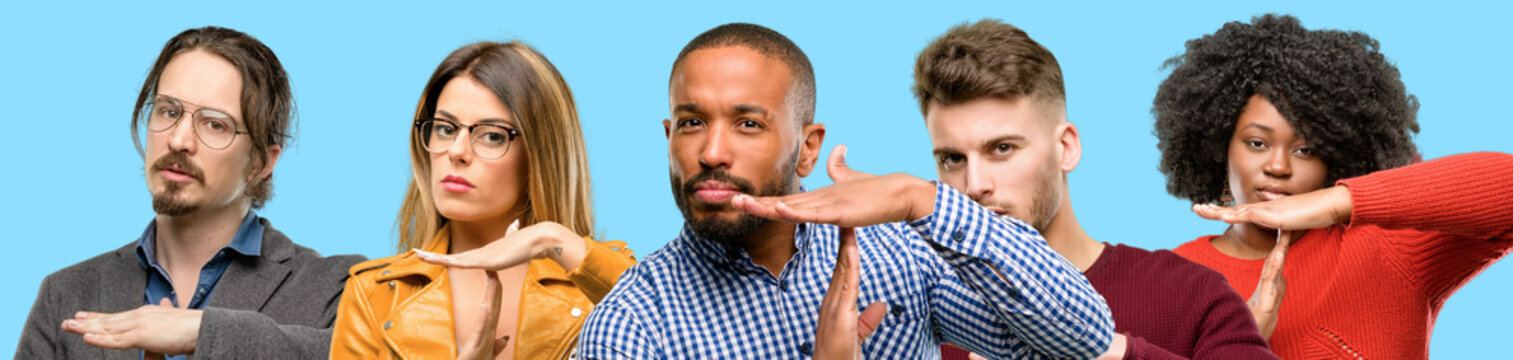 Group of mixed people, women and men serious making a time out gesture with hands