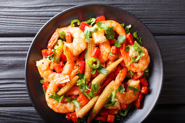 Mexican delicious prawns with pepper, garlic, corn cob and herbs close-up. horizontal top view
