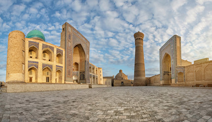 Panoramic view of Poi Kalan - an islamic religious complex located around the Kalan minaret in Bukhara, Uzbekistan