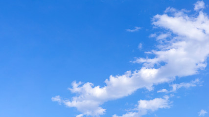 Blue sky background with white clouds, rain clouds on sunny summer or spring day.